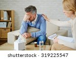 despaired man with pillow and... | Shutterstock . vector #319225547