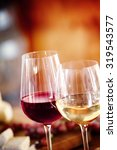 glasses of red and chilled... | Shutterstock . vector #319543577