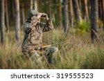 man hunter with shotgun looking ... | Shutterstock . vector #319555523