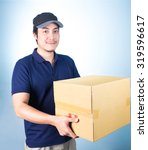 smiling handsome asian delivery ... | Shutterstock . vector #319596617