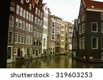 amsterdam  water canal next to... | Shutterstock . vector #319603253