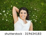 portrait of woman relaxing with ... | Shutterstock . vector #319634183