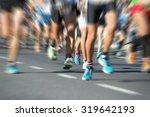 marathon runners in the race... | Shutterstock . vector #319642193