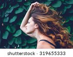 young woman against background... | Shutterstock . vector #319655333