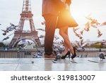 couple near eiffel tower in... | Shutterstock . vector #319813007