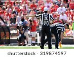Small photo of COLLEGE PARK, MD - SEPTEMBER 19: A football referee signals offsides during a NCAA football game September 19, 2015 in College Park, MD.