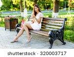 Beautiful Girl Sitting On A...