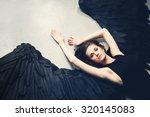 sensuality woman black angel... | Shutterstock . vector #320145083