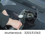Woman's Hand When Fueling A...