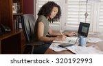 busy black woman in office... | Shutterstock . vector #320192993