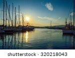 Sunset Behind The Yachts At...