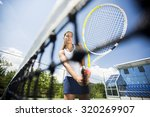 young woman playing tennis | Shutterstock . vector #320269907