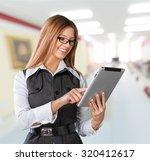 woman tablet. | Shutterstock . vector #320412617