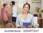 portrait of happy businesswoman ... | Shutterstock . vector #320497247