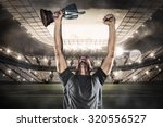happy rugby player holding... | Shutterstock . vector #320556527