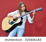 pretty young teen girl playing... | Shutterstock . vector #320606183
