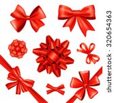 red silk gift bows and... | Shutterstock . vector #320654363