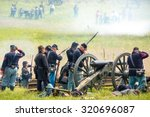 Unidentifiable union soldiers fight during the reenactment of the Civil War Battle of Gettysburg.