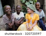 Small photo of UKEREWE - TANZANIA - JULY 2, 2015: Unidentified albino child and boys on July 2, 2015 in Ukerewe, Tanzania. Many traditional healers have been arrested recently in Tanzania because of albino murders