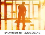janitor mopping in an office... | Shutterstock . vector #320820143
