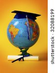 Globe with diploma - stock photo