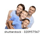 cute family  posing on a white... | Shutterstock . vector #320957567