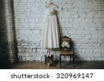 white wedding dress  shoes and... | Shutterstock . vector #320969147