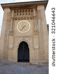 Small photo of Tangier, Morocco - April 4, 2015: Gold clock on Sidi Bou Abib Mosque in Tangier, Morroco
