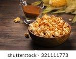 wooden bowl full of sweet...   Shutterstock . vector #321111773