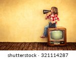 kid shouting through vintage... | Shutterstock . vector #321114287
