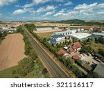 aerial view over small village | Shutterstock . vector #321116117