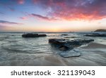 Stunning Sunset Over Rocks At...