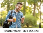 happy hipster man walking in... | Shutterstock . vector #321156623