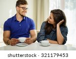 cheerful couple behind table at ... | Shutterstock . vector #321179453