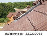Closeup Of New Roof With...