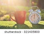 retro alarm clock with cup of...   Shutterstock . vector #321435803