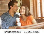 young couple drink coffee in... | Shutterstock . vector #321534203