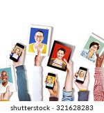 hands holding digital devices... | Shutterstock . vector #321628283