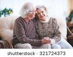 Happy Senior Man And Woman...