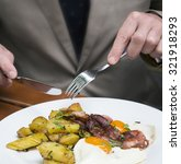 closeup of man in a suit eating ... | Shutterstock . vector #321918293