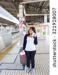 Small photo of YOGOHAMA, JAPAN - 15 April 2015 :Thailand tourists toured Japan is extremely popular. After the abolition of visas for tourists, Thailand tourist woman traveling with large bag and railway ticket.