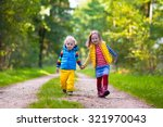 kids playing in autumn park.... | Shutterstock . vector #321970043