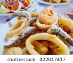 typical spanish fried fish in... | Shutterstock . vector #322017617
