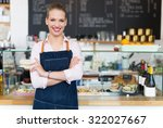 woman working at cafe | Shutterstock . vector #322027667