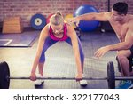 woman lifting barbell with her... | Shutterstock . vector #322177043