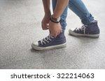 Girl In Jeans Wearing Sneakers...