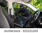 burglar stealing laptop from a... | Shutterstock . vector #322221203