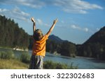 the boy raised his hands up... | Shutterstock . vector #322302683
