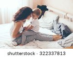young mother with her 2 years... | Shutterstock . vector #322337813