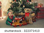 baby in elf costume playing... | Shutterstock . vector #322371413